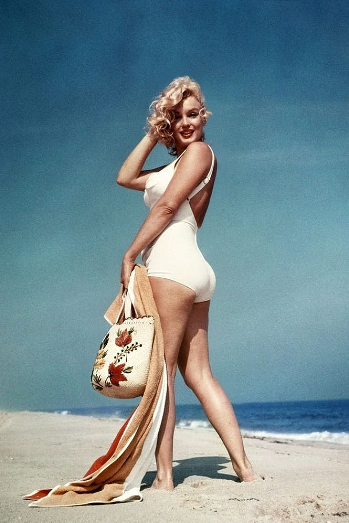 45130a56ff2 Luckily, if you are looking for Marilyn Monroe swimsuit pics you won't be  hard pressed to find them. She modeled plenty of sexy bikinis during her  time.